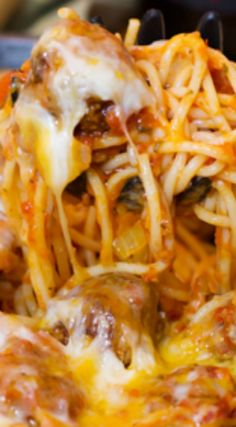 Baked Spaghetti & Meatballs ~ Cooked in one pan, topped with lots of cheese, and baked until hot, bubbly, and melted ooey gooey!