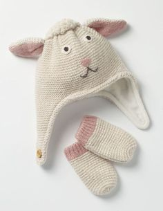 Keep little ones warm when there's a nip in the air with our playful hat. The knitted lamb has a soft, curly coat and even tiny ears. A handy button fastening holds it in place and the fleecy lining makes it super cosy.