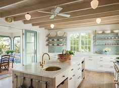 I Don't Care What You Say. I NEED MY CEILING FANS! cool kitchen