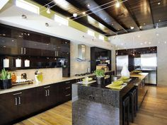 Spacious Kitchen    The #kitchen serves up a visual feast, with transom windows, crowning beams and a constellation of lights over the black granite island.