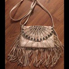 White & Silver Embellished Fringe Bag White & silver embellished fringe bag. Adjustable handle strap. Front snap closure. Zippered inside pocket & 2 open pockets. Bags Shoulder Bags