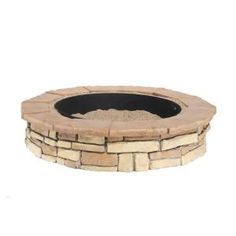 Provide a stylish addition to a backyard or other outdoor venue by including this multi-colored Random Stone Brown Round Fire Pit Kit from Fossill Stone. Stone Fire Pit Kit, Fire Pit Ring, Steel Fire Pit, Wood Burning Fire Pit, Concrete Fire Pits, Fire Pit Patio, Concrete Wood, Outdoor Fire, Backyard Patio