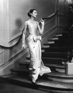 Christian Dior's H-line satin gown named 'Angelique' presented by    Dior house model Renee, 1954