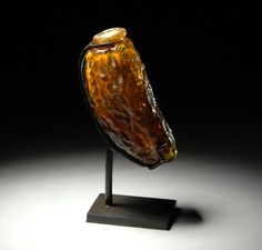 Ancient Roman Amber Glass Date Perfume or Ointment Flask -- Circa 100 CE -- No further reference provided.