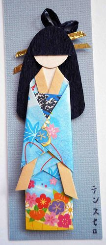 Bookmark with hand-folded Japanese paper doll mounted on card stock.  Materials: Kimono (origami paper); obi (yuzen washi); hair (crepe paper); hair decor (gold wrapping paper).