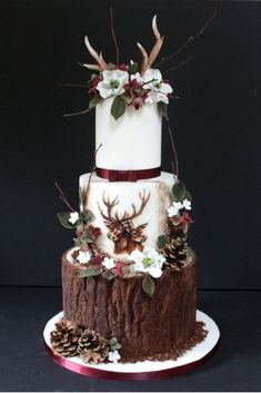 Our stag winter wedding cake featuring handpainted stag and doe, sugar hellebores, hydrangea and foliage and edible antlers. Debbie Gillespie Cake Design - supplying wedding cakes to Yorkshire, Greater Manchester and Cheshire cakes rustic Country Wedding Cakes, Wedding Cake Rustic, Unique Wedding Cakes, Wedding Cake Designs, Wedding Table, Camo Wedding Cakes, Deer Wedding, Autumn Wedding, Antler Wedding Decor