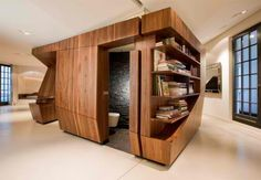 Free standing wood veneer kitchen/bathroom. For open loft apartments.