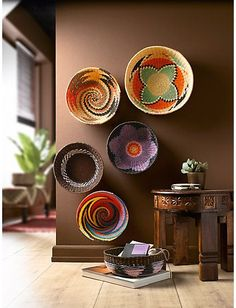 African decor continues to fuel patterns and designs. African decor is a huge umbrella term that takes in everywhere from Cote d'Ivoire to Morocco to Madagascar. Southwestern Decorating, Southwest Decor, Southwestern Baskets, African Home Decor, Deco Boheme, Unique Wall Art, Baskets On Wall, Decorative Wall Baskets, Cane Baskets