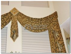 Classic Swag on Medallions with Jabot and Cascades. Close up picture.