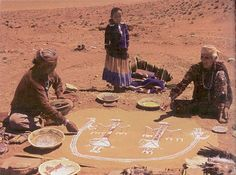 elders make traditional sandpaintings in the desert.