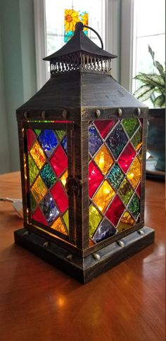 Inside Lantern made of tin, in antique bronze. Glass was removed and replaced with tiffany styled stained glass of many colors. Lantern is handmade and made to order. Lantern is 15 tall and 6 wide. Stained Glass Flowers, Faux Stained Glass, Stained Glass Lamps, Stained Glass Designs, Mosaic Glass, Glass Art, Glass Fusing Projects, Stained Glass Projects, Stained Glass Christmas