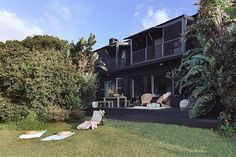 37 is a Sheffield Beach villa on the KwaZulu-Natal Dolphin coast framed and fanned by banana palms and ferns and dramatic strelitzia. Beach Villa, Beach House, Beach Accommodation, Banana Palm, Kwazulu Natal, North Coast, Rental Property, Sheffield, Dog Friends