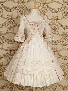 """""""Antoinette"""" short ivory dress with pale pink ribbon, flounces, & Rococo style sleeves from Mary Magdalene."""