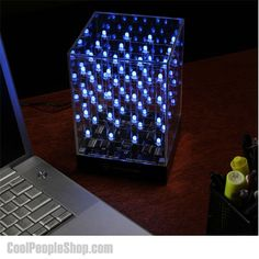 $114.95 Hypnotic Light Cube | Cool People Shop Hypnocube is art lamp meets kinetic art. Kinetic in the sense that the 4 by 4 by 4 three dimensional matrix of 64 LEDs constantly changes color.  Turn on some music and start your Hypnotic Light Cube to be mesmerized... it creates an amazing array of colors!