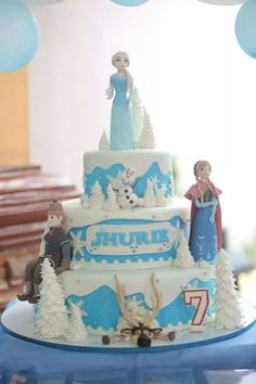 My first ever themed fondant tier cake. Frozen with edible figures of Elsa, Anna, Kristoff, Olaf and Sven :)