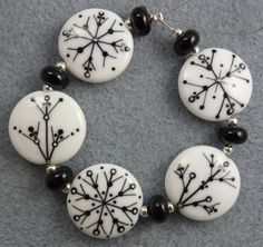 Winters song Lampwork bead set by Pixie Willow Designs. $65.00, via Etsy.