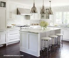 At Home in Arkansas - Classic kitchen with floor to ceiling Ikea white kitchen cabinets, ...