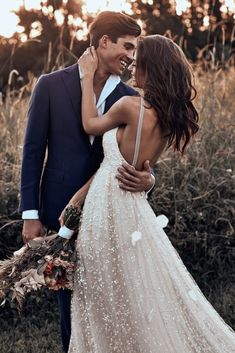 Free-Spirited Bohemian Icon Wedding Dress Collection by Graces Loves Lace   Textured low back Menha Gown @graceloveslace