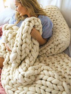 Giant knitted cream blanket in extreme merino wool   https://www.woolcouturecompany.com/product/epic-extreme-yarn/  #extreme #wool #yarn #knitting #hygge #cream #homedecor #knittedhome #handmade