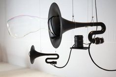 Huge black horns use compressed air to produce deep sounds that collide with fine membranes out of soapy water. The sound waves turn into . Installation Architecture, Sound Installation, Art Installations, Sound Wall, Sound Sculpture, Quirky Art, Drawing Projects, Interactive Design, Deco