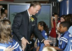 Peyton conecting with the kids at the children's Hospital