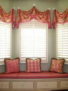 My 7 year-old client's bedroom.  A Pull-Up Valance w/trim and hung on medallions.  Very cute!