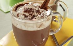 Ultimate Hot Chocolate - Savor a mug of rich hot chocolate topped with waves of freshly whipped cream. It's perfect for cold winter nights.