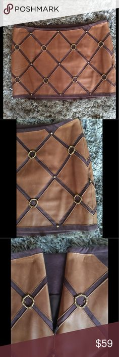 Brown genuine leather skirt - La Rok - small Never worn brown leather mini skirt, has butterscotch color leather squares and gold beading. Genuine leather; fully lined with side zipper. No missing beads, stains or rips. Waist 15.5 inch flat; length 12 inches. La Rok Skirts Mini