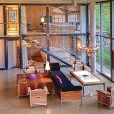 With floor to ceiling glass windows, concrete and steel, this luxurious loft in Switzerland is nothing short of spectacular!