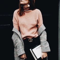 Black and white checked jacket over blush sweater and black pants.