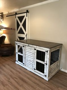 Urban Farmhouse designed indoor double dog kennel.  Features Sherwin Williams antique white distressed paint.  Comes standard with an interior center door that can be latched back to create one large space or locked into place to divide into two separate spaces.