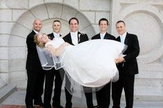 Have the groom and groomsmen hold the bride for a picture, so cute!
