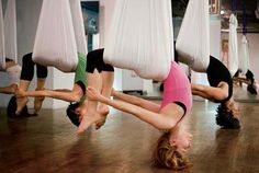 Anti Gravity Yoga- loooks like fun i'd prob flip out with my luck though!