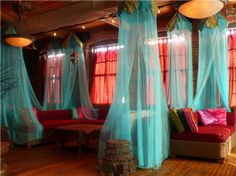Arabian nights them- coloured mosquito nets on the balcony and over couches/cushions