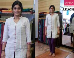 Stylish look she carries by the way, she has dressed half white Linen kurthi with banaras sleeve pattern and banaras buttons..