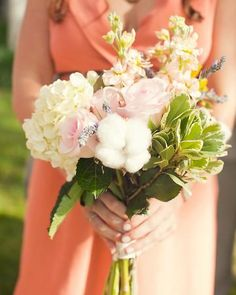 Individual bouquets with magnolia blooms and leaves and with cotton and hydrangeas. I loovvee it.