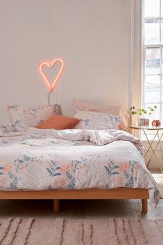 Lillian Floral Duvet Cover; reviews on Urban Outfitters say the pink is more neon than appears in the photos