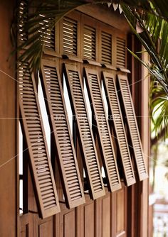 An exterior shot of French-style shutters at La Residence d& Siem Reap, Cambodia. The resort& architecture is a fusion of French colonial and classic Khmer design. Exterior Colonial, Design Exterior, Bungalow Exterior, British Colonial Decor, French Colonial, Style At Home, House Shutters, Exterior Shutters, Wood Shutters