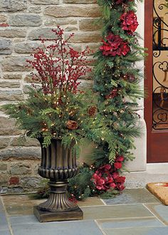 Create a dramatic and spectacular holiday presentation, whether on a front porch or patio entry!