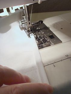 Sewing with a rolled hem foot.