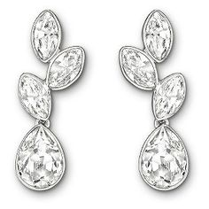 A stylish pair of rhodium-plated Swarovski earrings set with petal-shaped, fancy cut Swarovski crystals. Finished with a teardrop crystal these earrings inject a dash of elegant glamour into any attire.