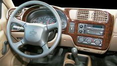Your interior's identity comes alive with a custom dash kit. Wood grain, carbon fiber, aluminum, even custom colors or camouflage will personalize your space. Chevy S10, Mini Trucks, Carbon Fiber, Wood Grain, Cars Motorcycles, Chevrolet, Automobile, Kit, Interior