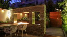 Avondbeeld-designtuin-met-verlichting-Erik-van-Gelder-kleine-tuin-luxe-design-met-lijnhaard-gashaard-met-afstandbediening-aardgas-buiten-haard-design-luxe-tuin.jpg