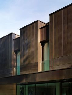 """#Astec_architectural_bronze facade,  #Astec_custom_patina  The facade that characterizes this project has been realized with panels of copper alloy with burnishing """"media a nuvole"""". For light sockets were opted for the perforated Corten, while for the windows was used patented technology #ABX_Architectural_Bronze series W65, K85 and L80 Relais San Lorenzo - Bergamo Italy - Natalini Architetti Firenze"""