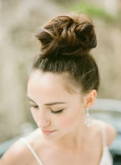high messy bun hairstyle for medium hair