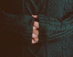 Turquoise sweater.
