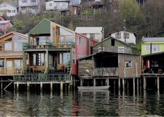 Chilean island of Chiloe - Panama Canal known for its waterfront stilt houses which have been converted into colorful hotels, coffee shops, and artisan co-ops.