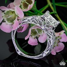 Verragio Pave Twist Diamond Engagement Ring is set in 18k white gold and holds a 1.083ct A CUT ABOVE® Princess Diamond.