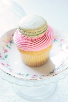 Vanilla and cherry cupcake topped with a pistachio macaron.