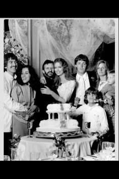 George, Ringo, and Paul with their wives